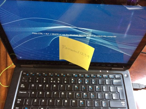 Computer with sticky note with password