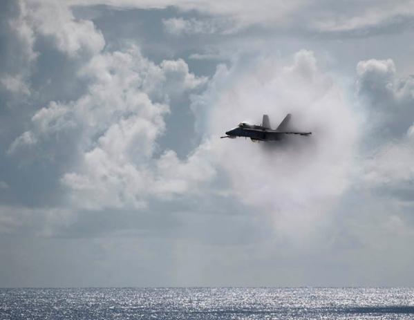Plane breaking through clouds