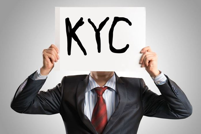 Man holding KYC sign