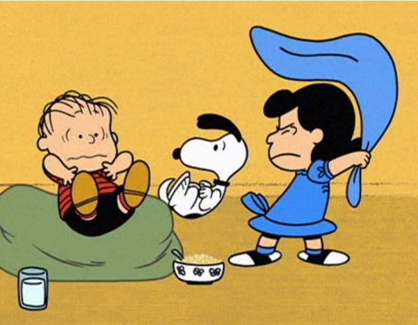 Lucy taking away Linus's security blanket